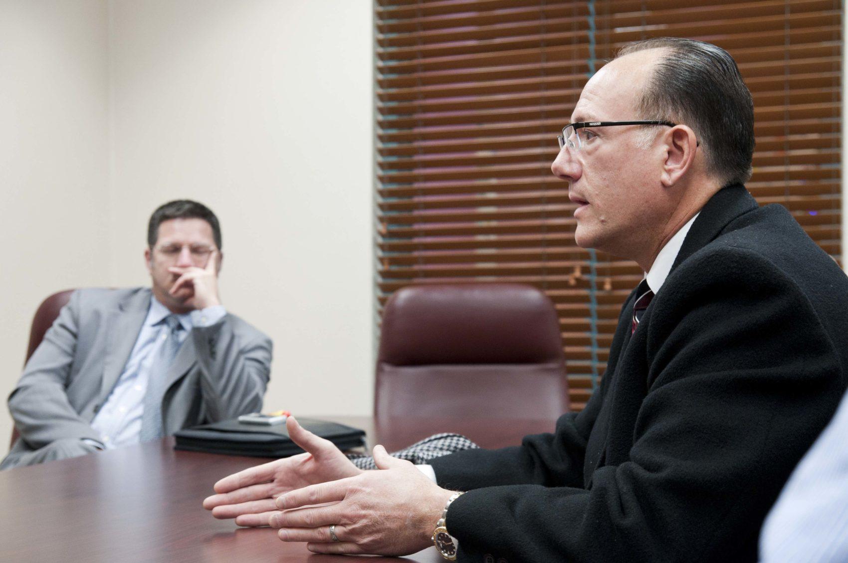 Image of men in meeting room